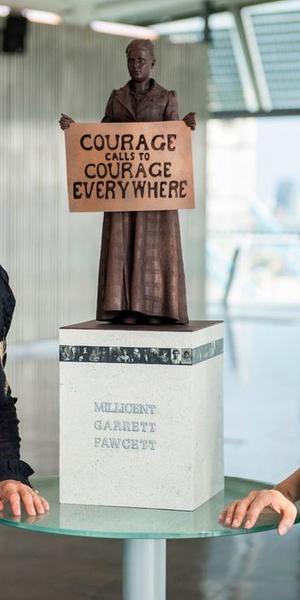 Deputy Mayor for Culture, Justine Simons, and artist Gillian Wearing stand with the statue of Millicent Fawcett.