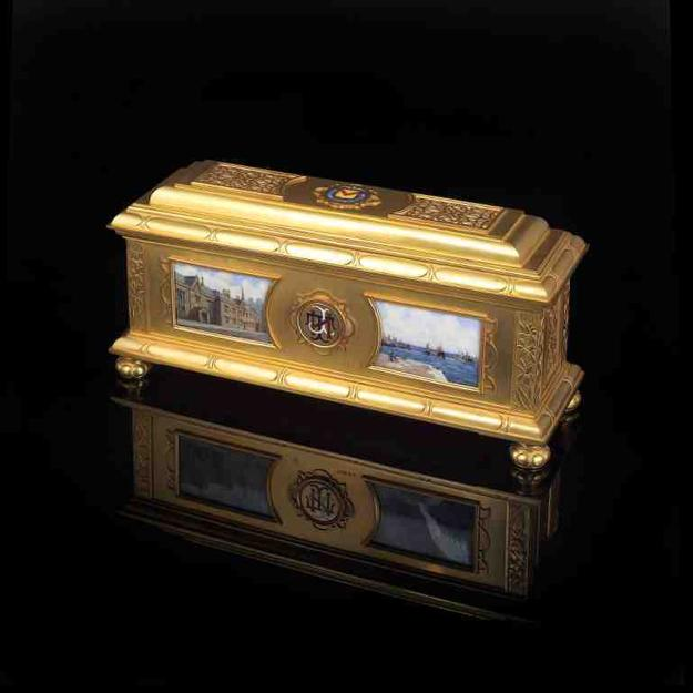 A MAGNIFICENT George V Gold Freedom Casket enamelled with the arms of the County Borough of Newport (Wales) , estimated at £18,000-22,000.