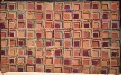 Corners Log Cabin pattern in terracotta, wine, sand and rose shades.