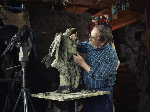 "Artist John Coleman sculpting ""Two Ravens"""