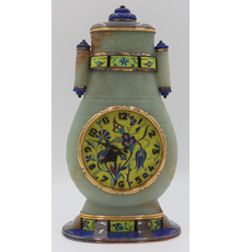 This fine jade, lapis, and enamel clock ($80/120,000), ex-Sotheby's and attributed to Cartier, features a beautifully-incised archaistic style jade vase with tube form handles and gold mounts.