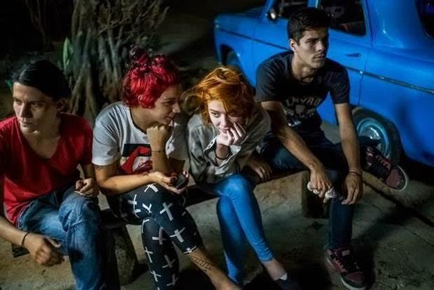 Michael Christopher Brown – Helen and friends wait for their $1.00 cheese pizzas in Playa neighborhood, Havana.