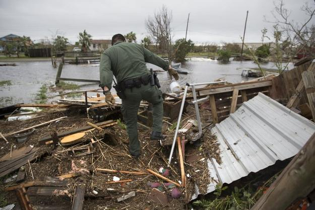 A U.S.  Border Patrol agent searches for survivors in the wake of Hurricane Harvey near Rockport, Texas, on August 27, 2017.