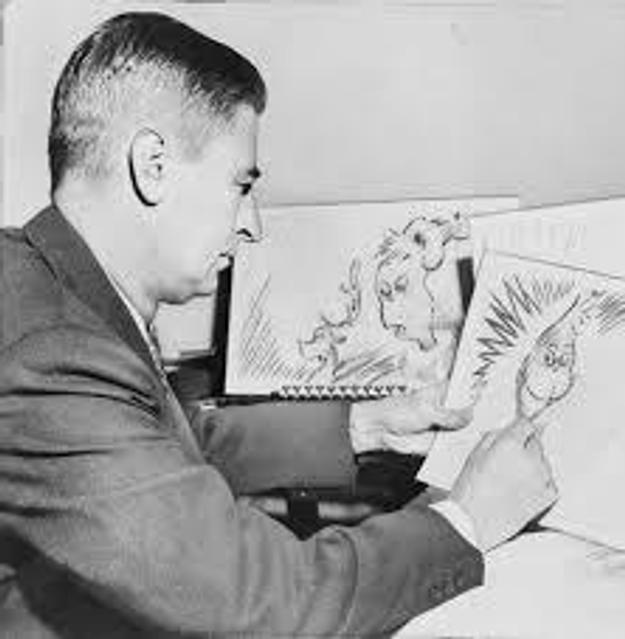 "Theodor Seuss Geisel, ""Dr.  Seuss,"" at work in 1957."