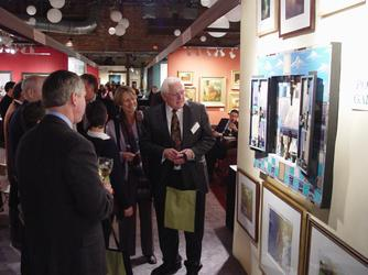 Gala preview attendees have the first choice of works on view.  Photo by Robert Four.