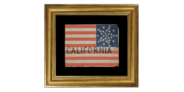 """From Jeff R.  Bridgman, 31 stars arranged in a rare variation of the """"great star"""" pattern, with the word """"California"""" painted in the stripes, a pre-civil war flag, California statehood, 1850 - 1858, part of a series of these flags, thought to have been used at the Wigwam convention (the 1860 Republican national convention) in Chicago."""