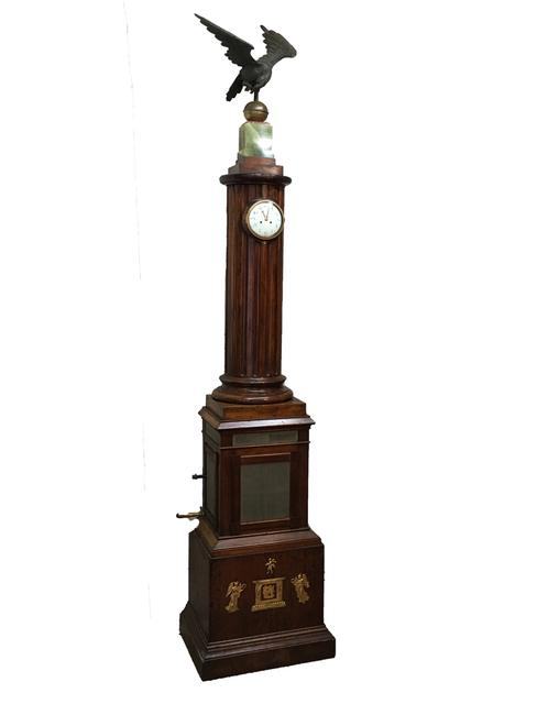 Magnificent 19th century French barrel organ clock, circa 1884, 8 feet 6 inches tall, topped by a bronze eagle perched on an alabaster plinth, a carved fluted column containing the clock.