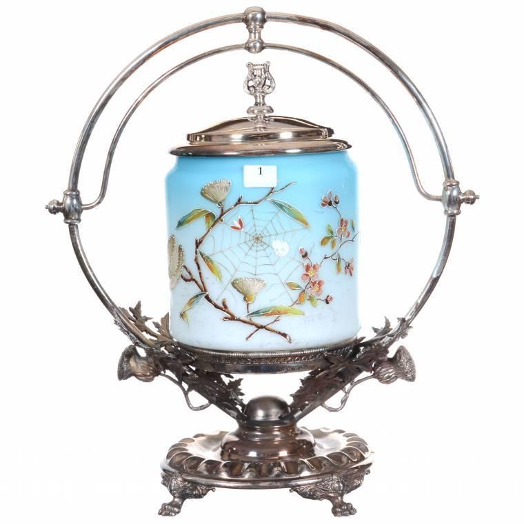 Victorian blue satin art glass biscuit jar, boasting enamel thistle and a spider web decor, set on an elaborate Wilcox #8444 silverplate frame.