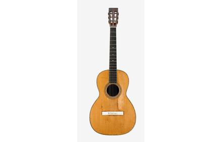 C.  F.  Martin Guitar, Style 0-40, c.1880, used in performances and recordings by Joan Baez 1966-68.  Sold for $12,500.