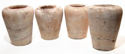 Set of four large Egyptian alabaster canopic jars (Late Period, circa 664-332 BC), each jar carved from a creamy stone with horizontal veins (est.  $9,000-$15,000).