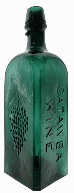 Catawba Wine bitters bottle with embossed grapes, circa 1860-1866, with overall crudity and pontiled variant, making it the finest example known ($18,400).