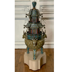 Chinese cloisonné brazier in pagoda form resting on a tripodal imperial Nara deer base, on a pedestal, 52 inches tall, including the 8 ½ inch tall 20th century pedestal.