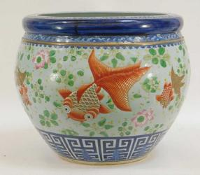 Chinese Qing Dynasty porcelain fish bowl, 19th century or earlier, finely decorated, with an incised band of goldfish swimming amongst lily pads and lotus flowers (est.  $2,000-$3,000).