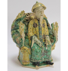 19th century Chinese porcelain Sancai statue of a seated bearded man (or emperor), decorated with a five-toed dragon upon a dragon throne.  Estimate: $1,000-$2,000.