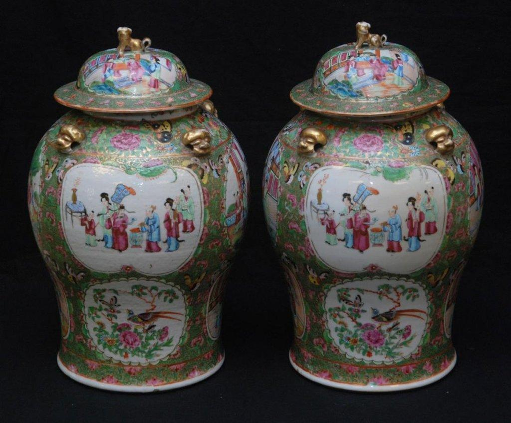 This extraordinary pair of Chinese hand-painted covered urns, with dog finials, 17-1/2 inches tall, will be sold at auction Nov.  22 in Florida.