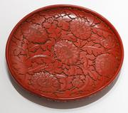 Plate with Chrysanthemum Pattern, Ming dynasty, 14th-15th Century; possibly late Yuan dynasty (1260-1368), Carved red lacquer, H.  1 1/2 in.  DIAM.  11 1/2 in.