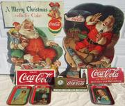 The auction will feature a wide array of Coca-Cola memorabilia, including these items pictured here, all of which will be desirable to Coke collectors.