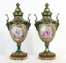 Pair of gilt metal mounted porcelain covered urns.