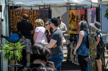 Visitors walking and observing art at the 2018 Highland Park Festival of Fine Arts.