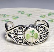 Lovely piece of Belleek Irish china from either a broken antique cup, saucer or plate and installed in a sterling silver cuff bracelet.