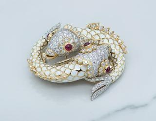 Rare and brilliant David Webb enamel and ruby double fish brooch in the original box (est.  $12,000-$20,000).