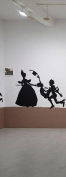 Kara Walker The Nigger Huck Finn Pursues Happiness Beyond the Narrow Constraints of your Overdetermined Thesis on Freedom — Drawn and Quartered by Mister Kara Walkerberry, with Condolences to The Authors, 2010 Cut paper and paint on wall and gouache and ink on paper.  Approximately 57 feet.