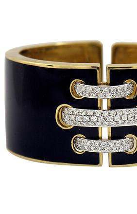 An exquisite bracelet by David Webb in 18K yellow gold, from Benchmark of Palm Beach