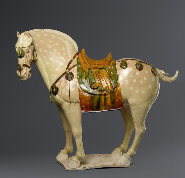 From Christian Deydier, a Three-colour Horse Earthenware in sancai glaze.  China, Tang Dynasty, 618 – 907.  Height: 26 in.  (66 cm) Length: 30 ¾ in.  (78,5 cm) .