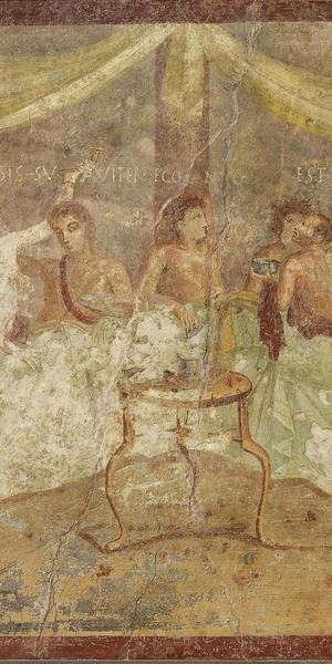 Fresco wall panel showing a dinner party with painted messages: FACITE VOBIS SUAVITER EGO CANTO and EST ITA VALEAS (make yourselves comfortable; I am singing; go for it!) AD 40–79, Pompeii, House of the Triclinium, 68 x 72 cm.  Museo Archeologico Nazionale di Napoli