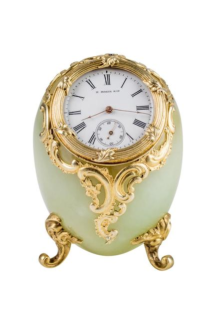Egg-shaped desk clock Firm of Fabergé, workmaster Mikhail Perkhin St.  Petersburg, Russia, before 1903.  Bowenite, gilded silver, enamel.  Private collection, New York, NY