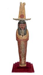 Egyptian polychrome Ptah-Sokar-Osiris from the Late Period (circa 1075-974 BC), depicted mummiform on a rectangular integral base, wearing a tripartite headdress (est.  $6,000-$9,000).