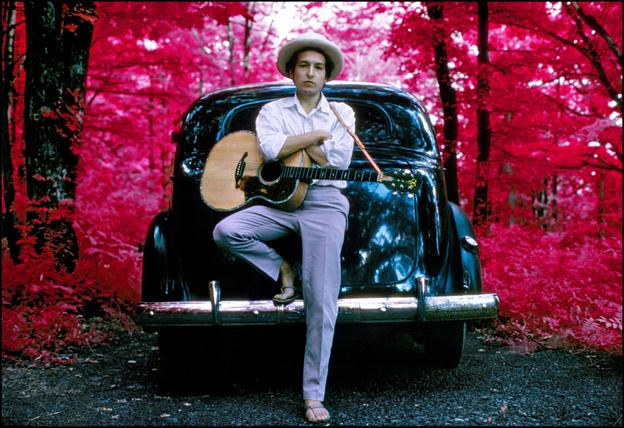 Image Caption: Elliott Landy, Bob Dylan, Outside his ByrdCliffe Home, infrared color film, Woodstock, NY, 1968.  Cibachrome print; printed 2013, 16 x 20 inches.  Courtesy of Scott Nichols Gallery, San Francisco