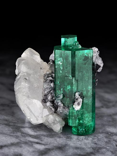 Emerald on Calcite, from the most famous of all emerald mines, Muzo Mines, Muzo, Boyaca, Colombia.  5 cm.  tall by 5 cm.  wide (formerly in the James Horner collection, and currently in the collection of Mr.  Irv Brown)