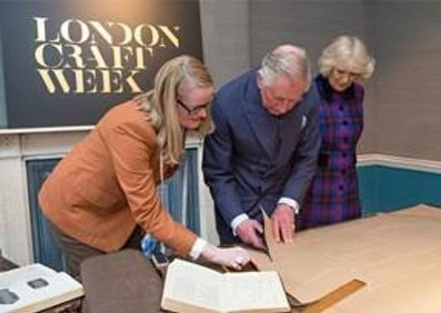 HRH The Prince of Wales with The Duchess of Cornwall, tries his hand at pattern cutting with tailor Kathryn Sargent.