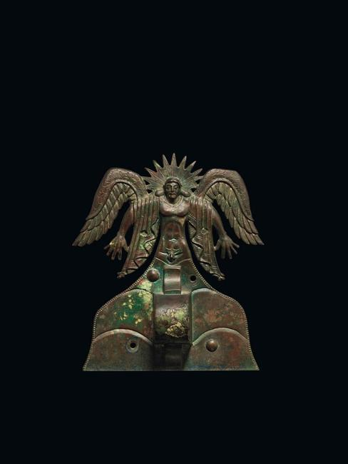 Appliqué depicting the Sun God Usil, Etruscan, 500 - 475 B.C.  Italy, made in Vulci.  Bronze.  H: 20 cm (7 7/8 in.) The J.  Paul Getty Museum, Villa Collection, Malibu, California