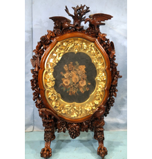 Rare, museum-quality rococo rosewood fire screen in mint condition, the finest piece of Victorian rococo Stevens Auction has seen in 40 years, 55 inches tall (est.  $15,000-$30,000).