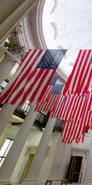 Exhibition view of A Living Thing: Flag Exchange, curated by Hesse McGraw, at Federal Hall, New York, 2017.  Photo: Guillaume Ziccarelli