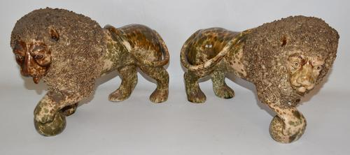 Pair of rare flint enamel Bennington Rockingham glaze lions by Lyman, Fenton & Company, circa 1840-1850, 7 ¾ inches tall by 11 inches wide.