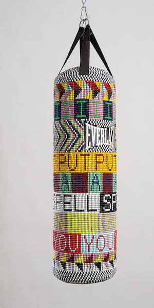 Jeffrey Gibson (Mississippi Band Choctaw/ Cherokee), I PUT A SPELL ON YOU, 2015.  Repurposed punching bag, glass beads, artificial sinew, and steel; 40 × 14 × 14 in.  Collection of the Nasher Museum of Art at Duke University, Durham, North Carolina.  Museum purchase, 2015.11.1.  Image courtesy of Jeffrey Gibson Studio and Roberts Projects, Los Angeles, California.  Photograph by Peter Mauney.