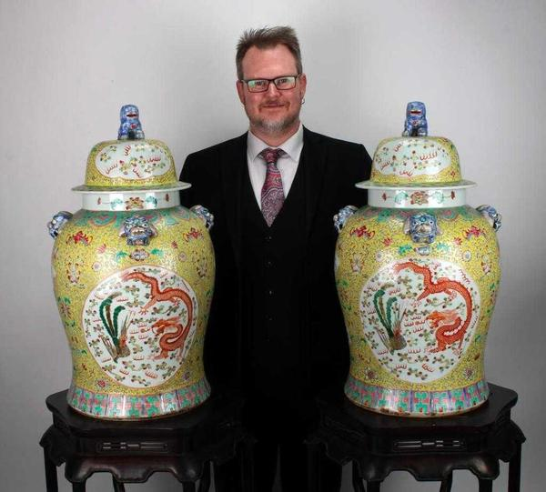 Large pair of famille jaune (yellow Chinese porcelain) dragon and phoenix ginger jars with foo dog finials on the lid, 14 inches tall (est.  $2,000-$4,000).