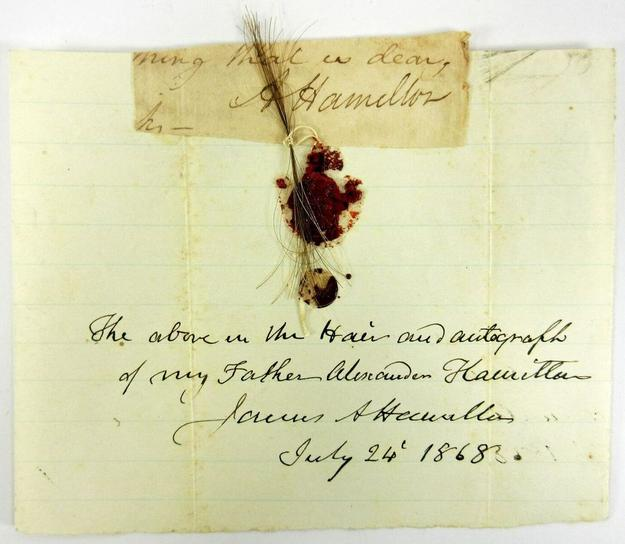 Lock of Hamilton's hair, and his signature, with a seal and note penned by a descendant in 1868.