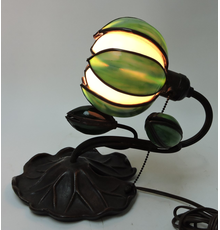 Handel bronze desk lamp modeled with a large lily pad base and stem holding leaded glass bud and lighted water lily lamp, 10 ½ inches tall (est.  $300-$500).