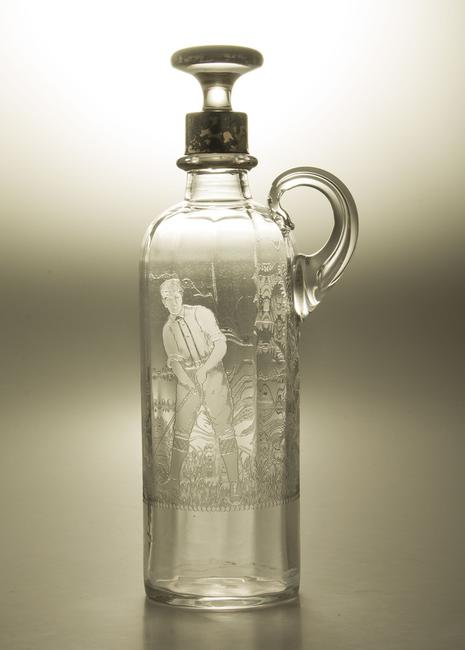Locke art glass liquor decanter with golf theme valued at $250/500 in Witherell's Holiday Auction Dec 6.