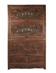 Chinese huanghuali lotus cabinet, elaborately carved all over in three-dimensional designs.  The three top doors lift up and slide in, and there are two drawers underneath (est.  $2,000-$4,000).