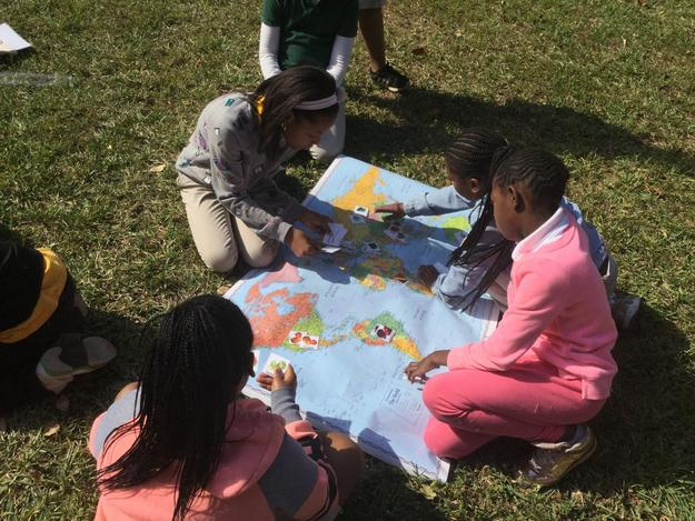 Students map the journey of common fruits and vegetables from their place of origin around the world to Miami, Florida
