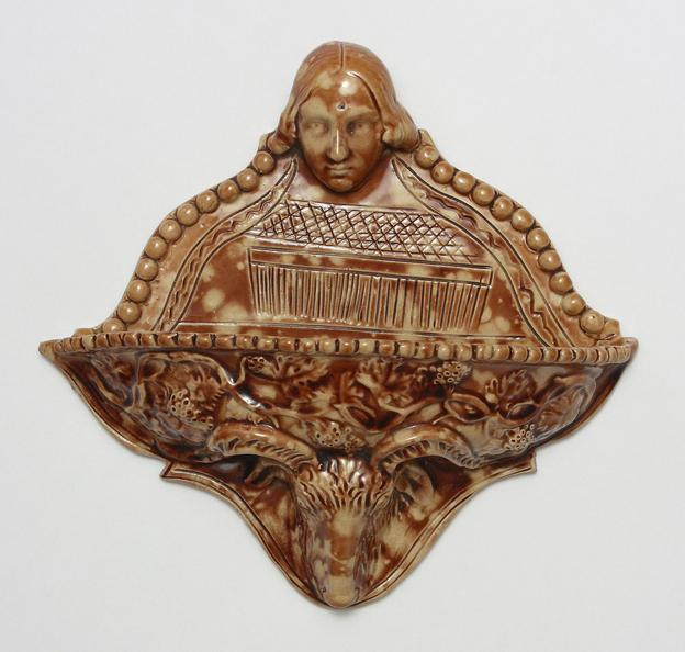 A wall-pocket piece of pottery signed by Thomas H.  Personette and dated March 6 1860