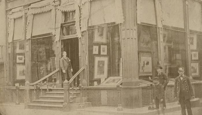 Charles L.  Knoedler (1863–1944), the youngest son of Michael Knoedler, at the gallery's fourth location, a rented brownstone at the intersection of 170 Fifth Avenue and 22nd Street in New York City.  The Getty Research Institute, 2012.M.54