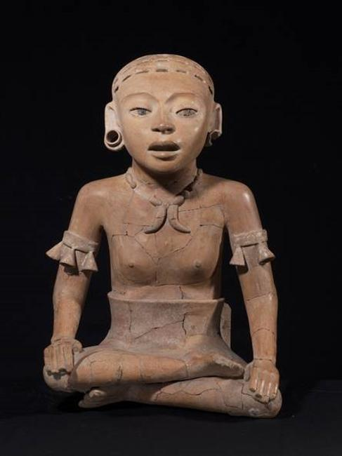 An important 21 inch tall Veracruz Remojadas figure of a young woman, dating to 600-900 CE.
