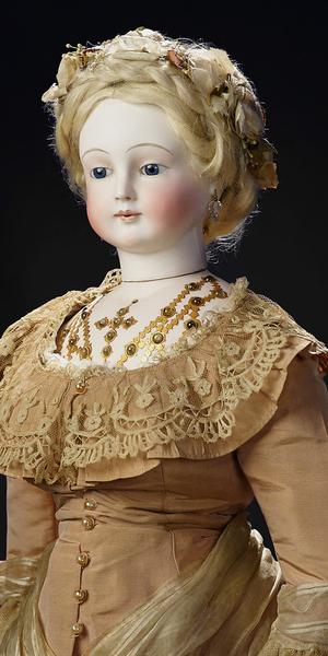 The very rare French doll by Rochard sells for $333,500 and captures a new world record for a doll at auction at a recent Theriault's event.