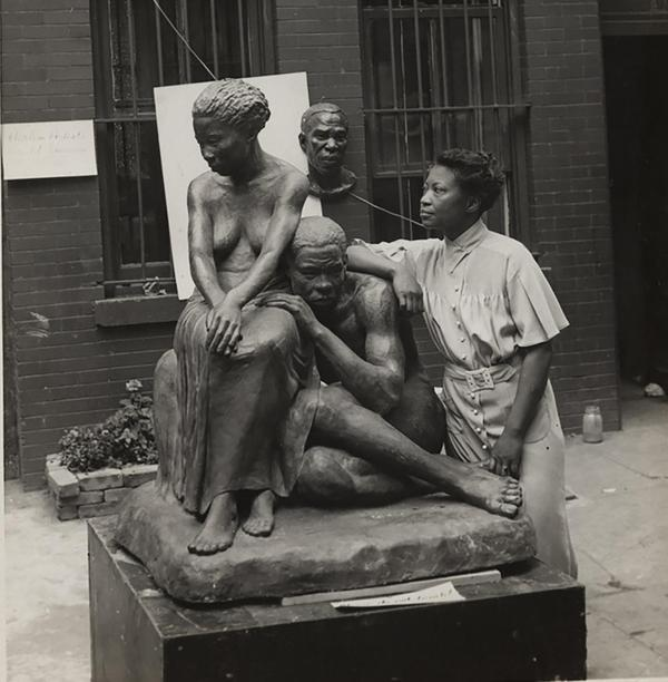 Andrew Herman (active 1930s–1940s), Federal Art Project, Works Progress Administration, Augusta Savage with her sculpture Realization, 1938.  Schomburg Center for Research in Black Culture, NYPL, Photographs and Prints Division, Astor, Lenox and Tilden Foundations, 86-0036.